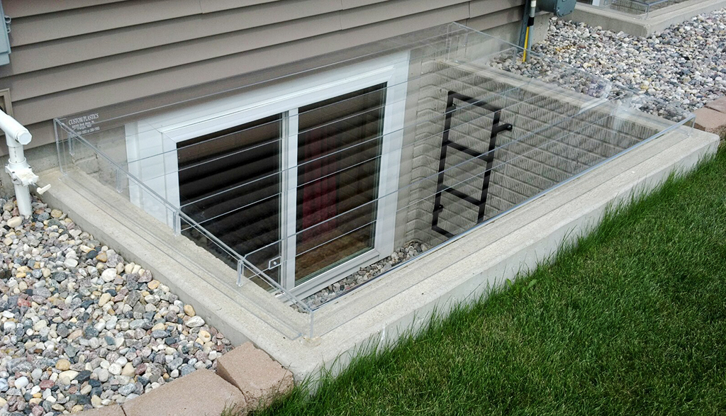 Acrylic egress window well covers custom plastics fargo nd for Window cover for home